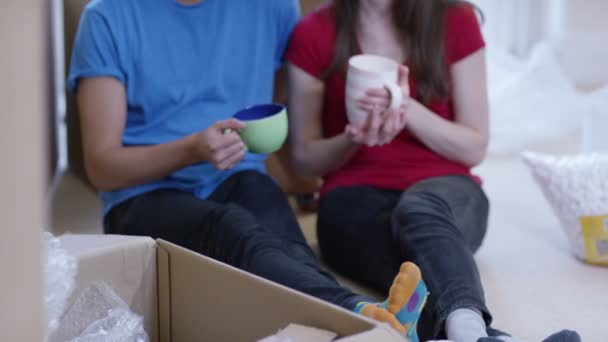 Take Break Coffeebreak : Couple take a coffee break from unpacking boxes u stock video