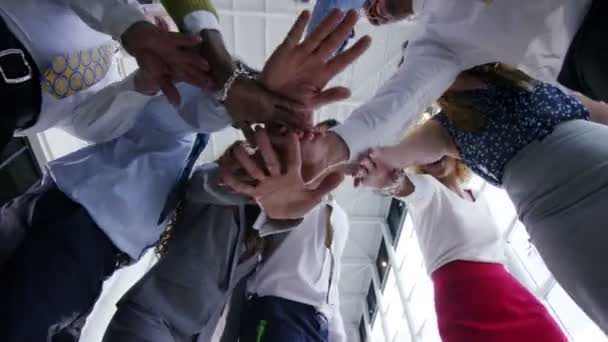 business team put their hands together
