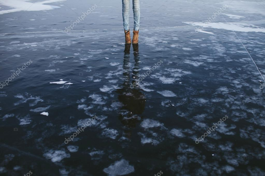 female legs on the cracked ice clean