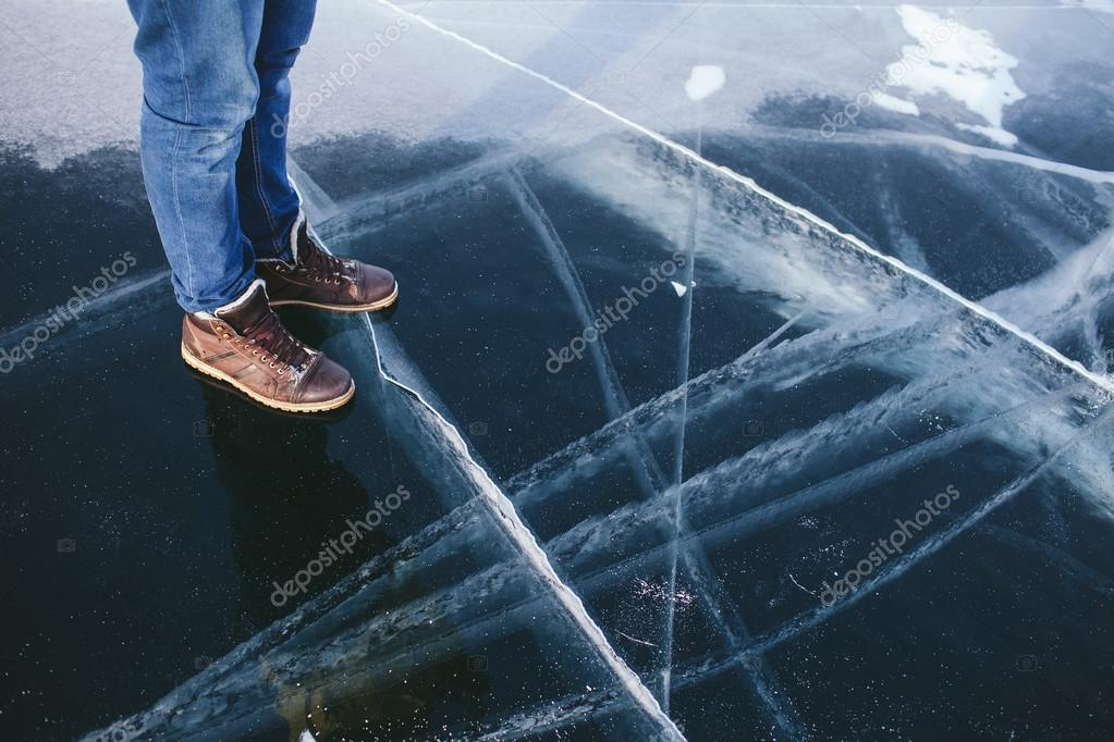 men's legs on the cracked ice clean