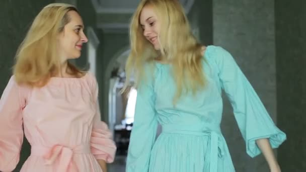 blonde sisters in beautiful dresses at home