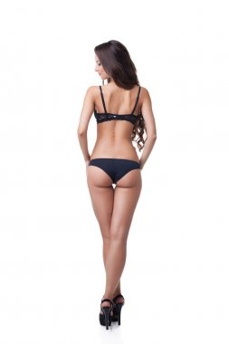 Rear view of suntanned girl in black lingerie