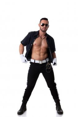 Image of sexy muscular cop posing at camera
