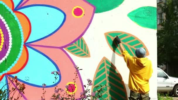 Modern urban art - man drawing with spray on wall
