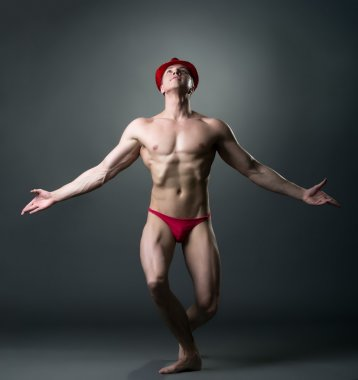 Dance for adults. Image of sexy brawny male dancer