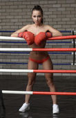Photo Sexy brunette waiting for opponent in boxing ring