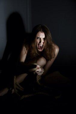 Human trafficking. Exhausted girl shouts at camera