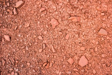 red iron mineral ground with stones
