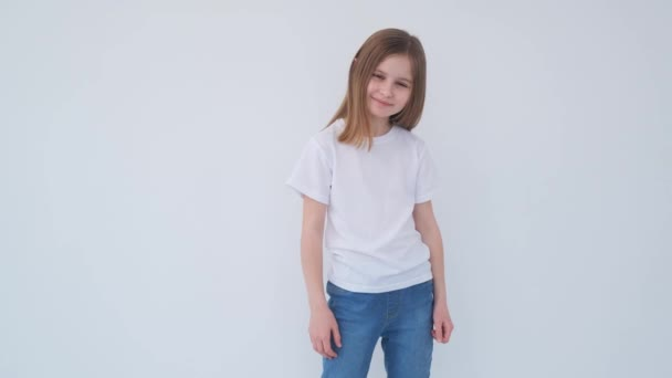 Cute little girl smilling in a white t-shirt