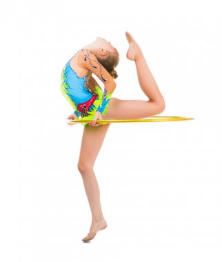 little gymnast doing an exercise with hoop