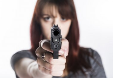 Young Woman Pointing a Gun at the Camera