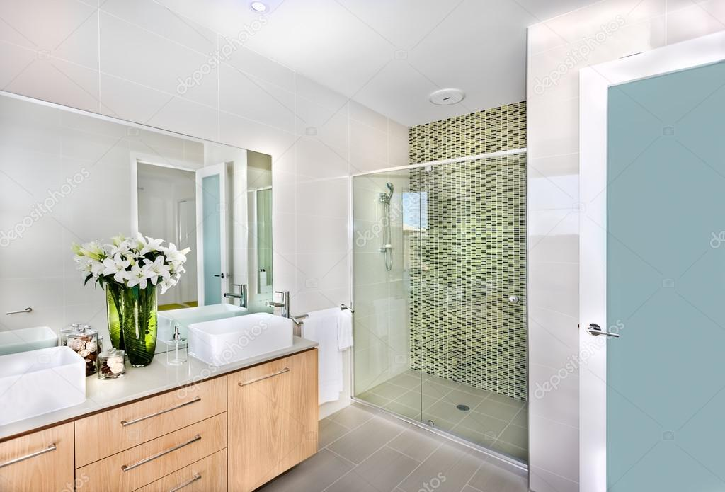 A Modern Bathroom With White Flowers In The Vase Stock Photo