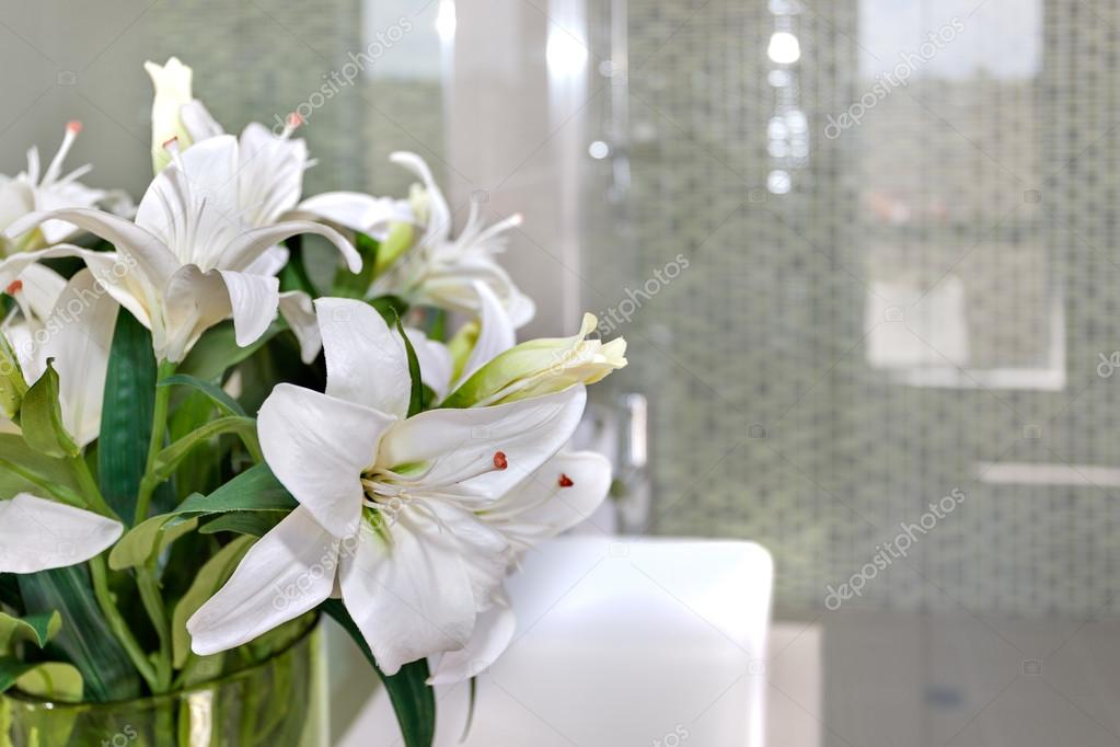Bunch Of White Flowers On The Glass Of A Room With Blurred Backg