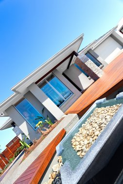 New design of a modern house and garden including stone decorati
