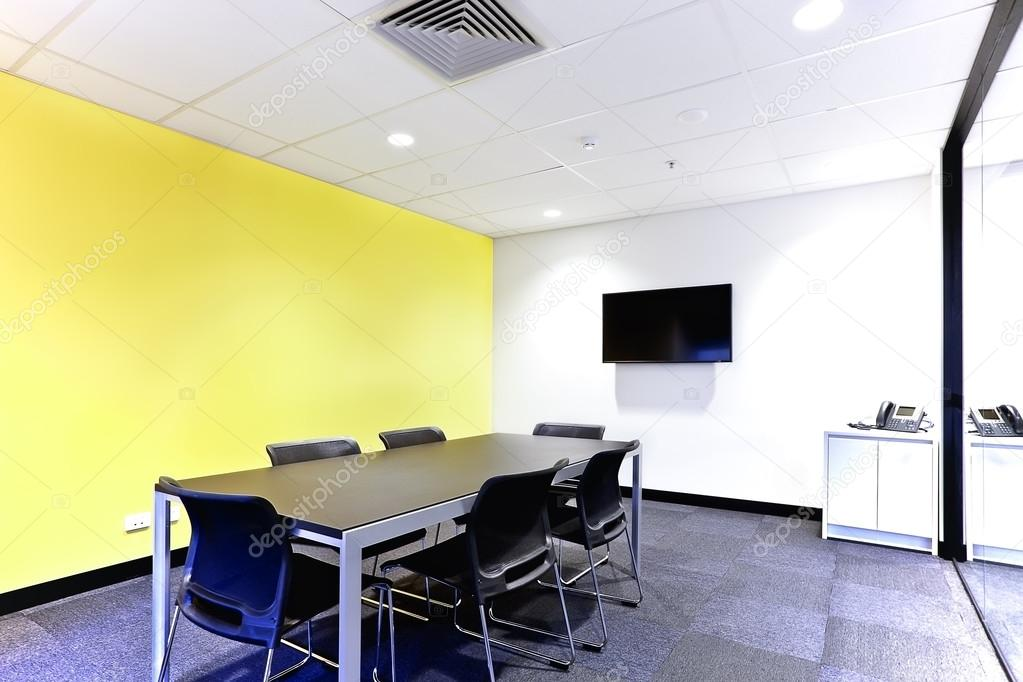 Conference room with black table and chairs covered walls — Stock ...
