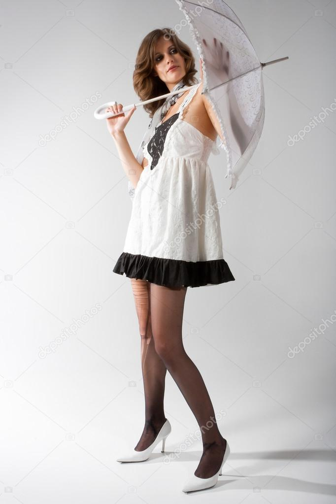 Brunette In A Black Tights Dress With An Umbrella Stock Photo