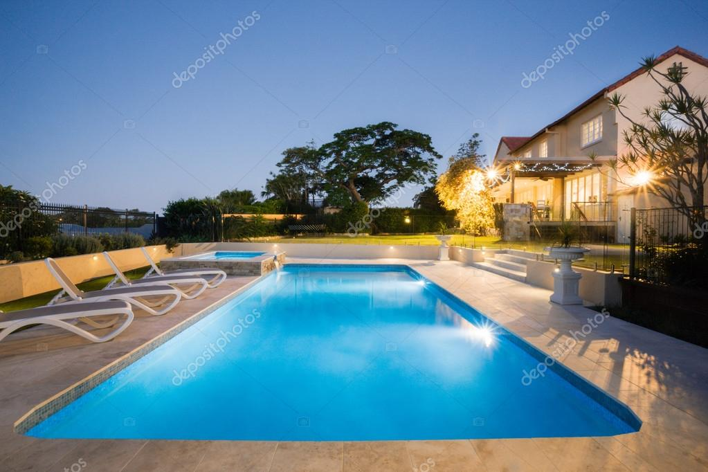 home swimming pools at night. Luxury Swimming Pool With Blue Water At Night Flashing Lights From The Large House Garden \u2014 Photo By Jrstock1 Home Pools