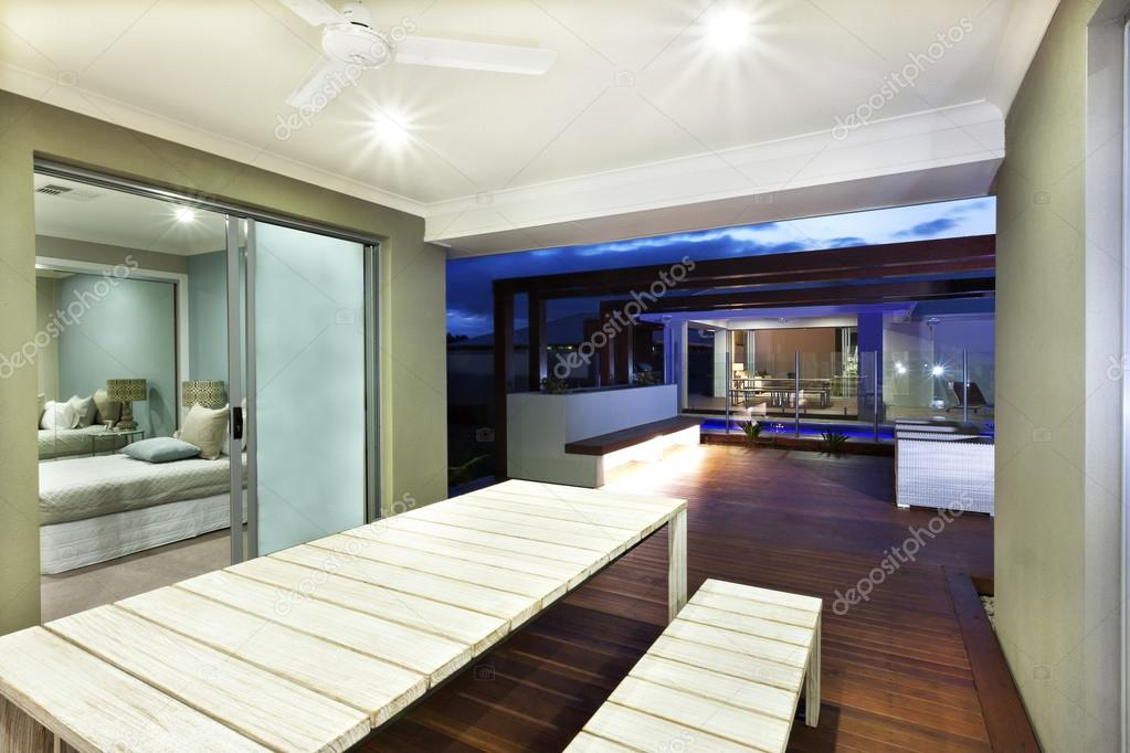 Interior Lights For House. Interior lighting of a house with patio area at night  Stock Photo