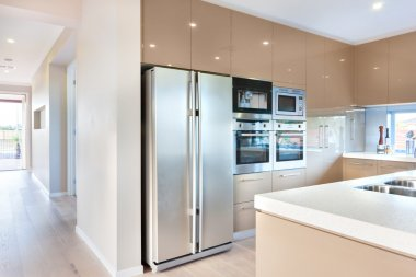 A modern refrigerator in the luxury kitchen with microwave ovens
