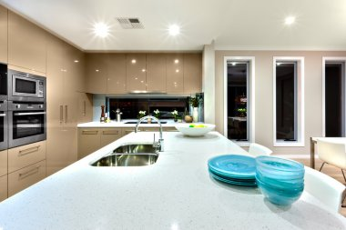 Closeup of a white cermic countertop in a modern kitchen interio