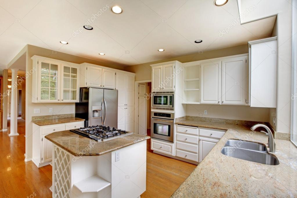 Classic American Kitchen Interior With White Cabinets And Built In