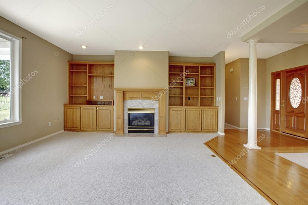 living room in open floor plan with foyer view and wooden entrance