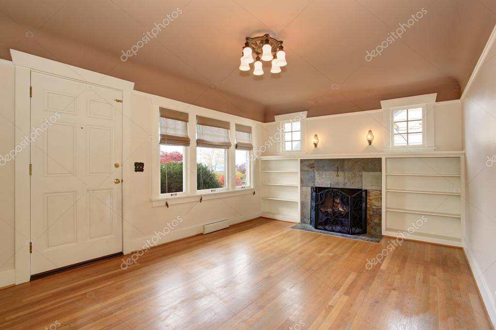 Empty Living Room Interior With Mocha Ceiling And Tile Trim
