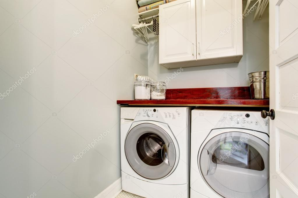 Small laundry room with tile floor door and washer dryer set stock photo iriana88w 116617674 - Small space laundry set ...