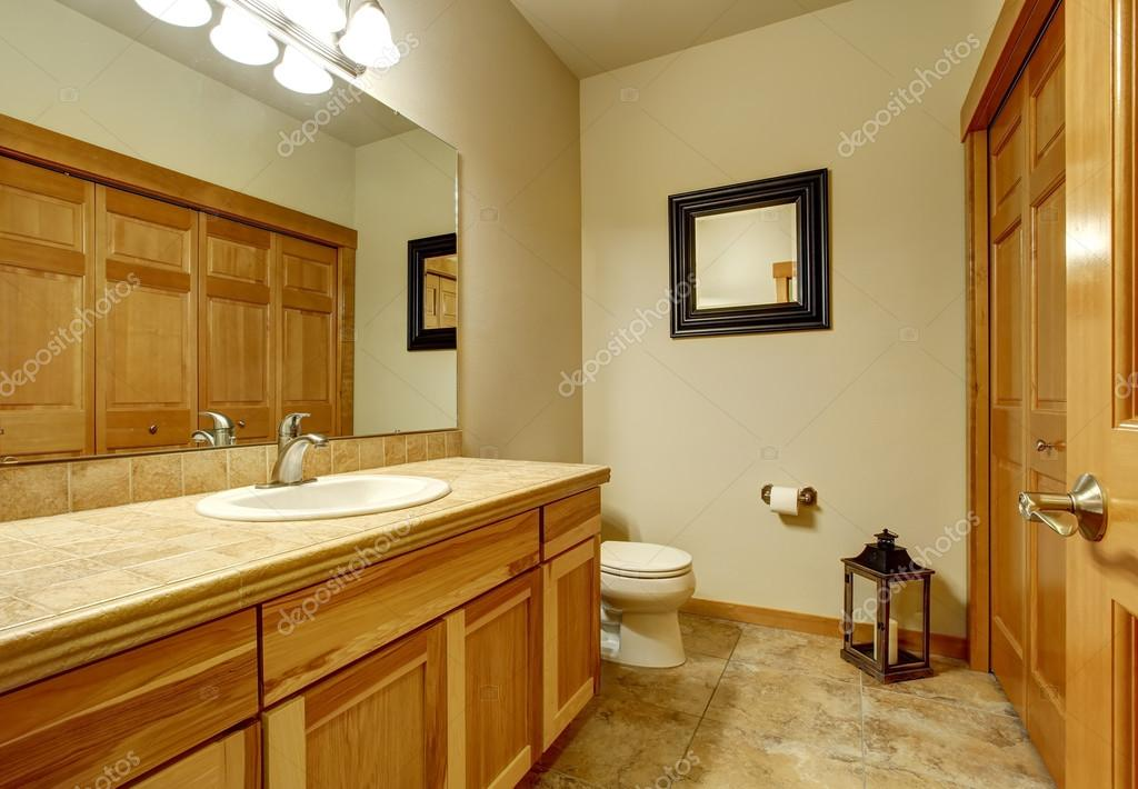 Light Brown Bathroom With Marble Tile Floor And Beige Walls Stock
