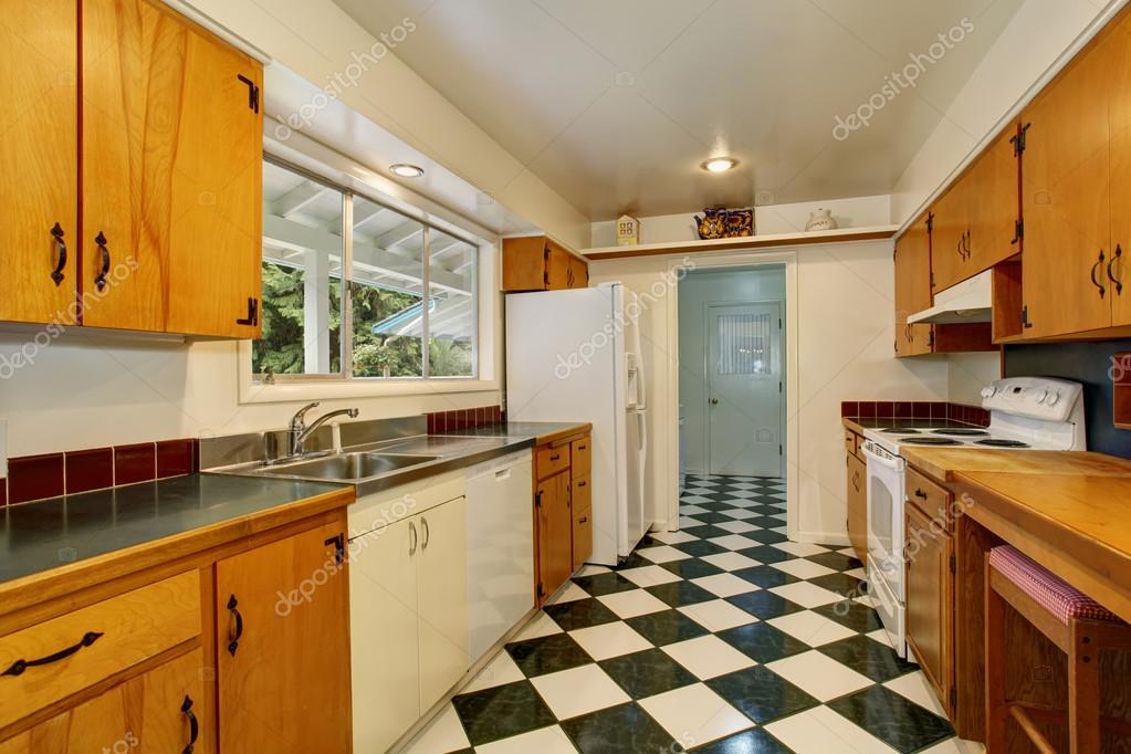 Narrow Kitchen Room Interior With Light Brown Cabinets White And Black Tile Stock Photo C Iriana88w 117750382