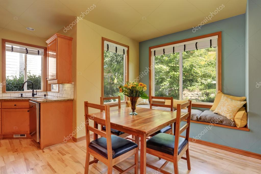 Dining Area With Wooden Table Set And Cozy Sitting Place