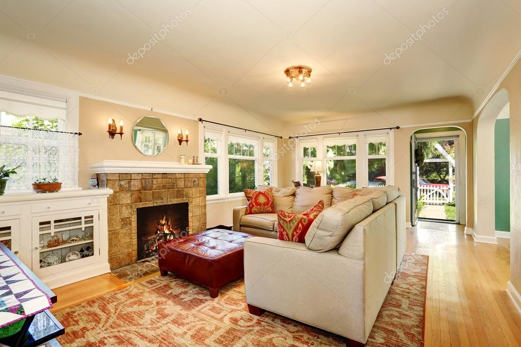 Cozy living room interior with brick fireplace and beige ...