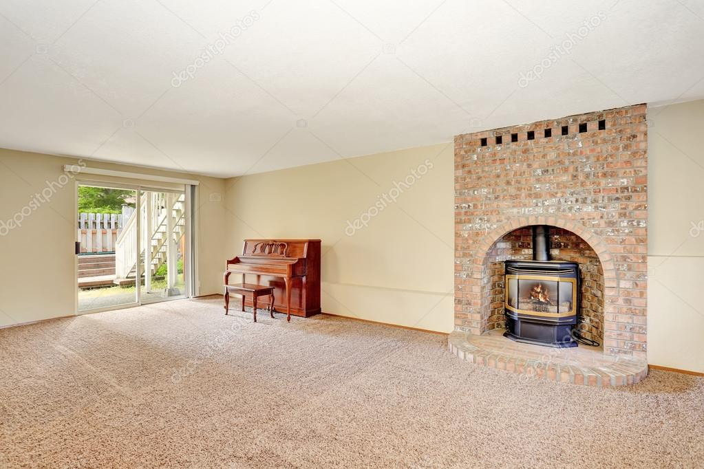 Empty living room interior with fireplace, carpet floor and ...