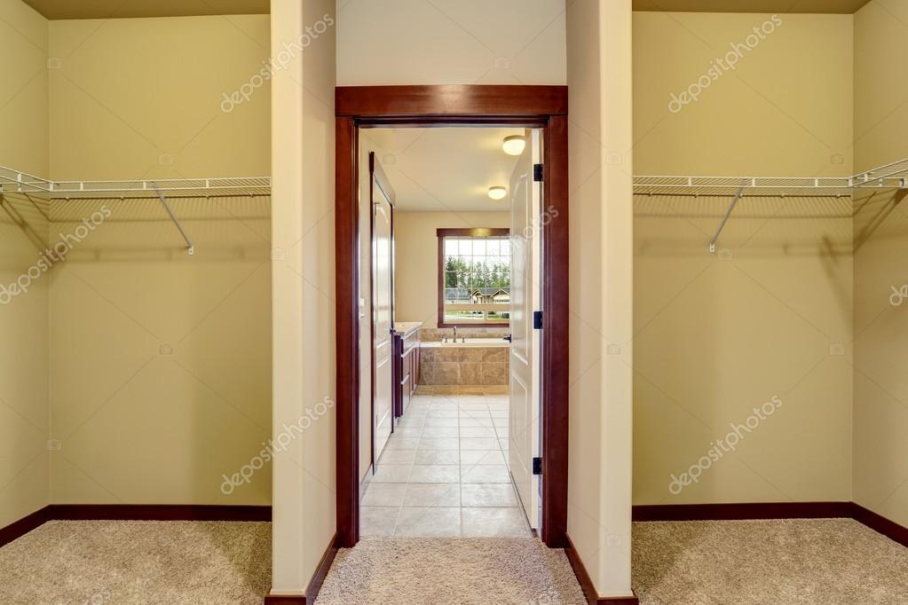 Hallway Interior Opened Door To Bathroom With Tile Floor
