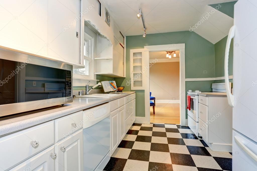 Classic Kitchen Room Interior With Blue Walls And White Cabinets