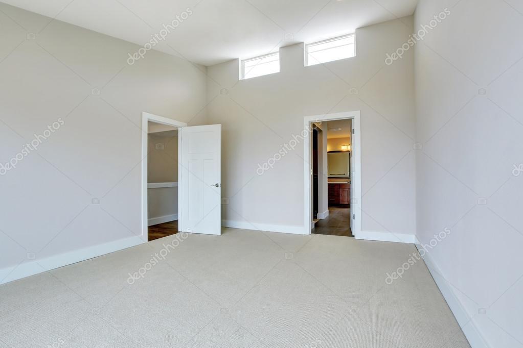 Empty Room Interior With Carpet Floor And Opened Bathroom Door