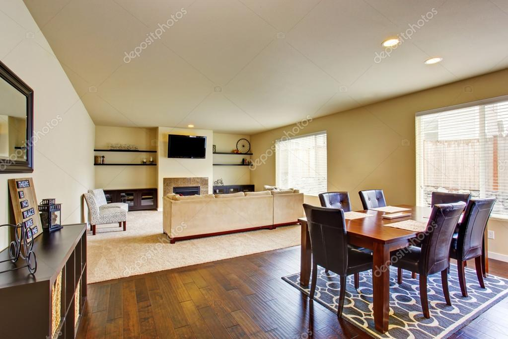 Spacious Dining Area With Wooden Table Set Connected To Living Room Fireplace And Carpet Floor Northwest USA Foto Von