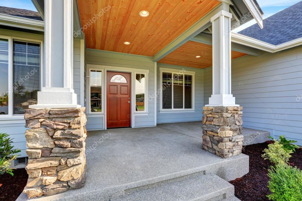Light blue siding house porch with stone base columns stock photo iriana88w 120972136 for Illumination exterieur maison