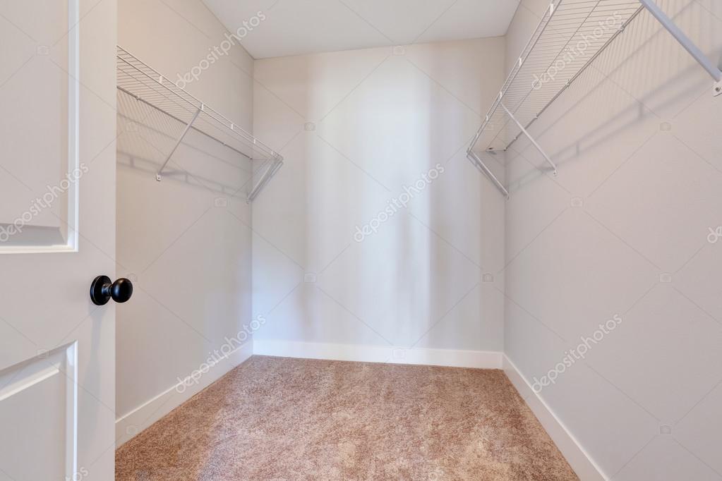 empty small walkin closet with shelves and carpet floor u2014 stock photo empty walk in l68 closet