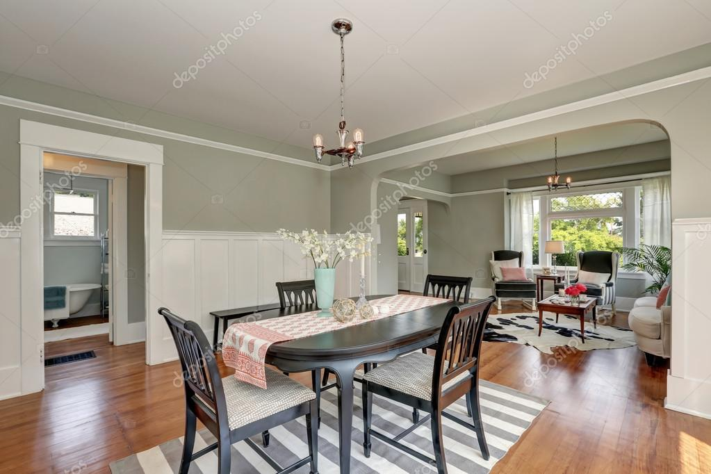 Complete Eetkamer Set.View Of A Classic Dining Room With Gray Walls And Hardwood Floors