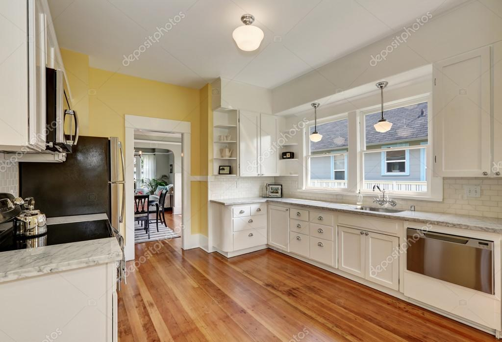 astounding white kitchen cabinets wood floors | Kitchen interior with white cabinets, yellow walls and ...