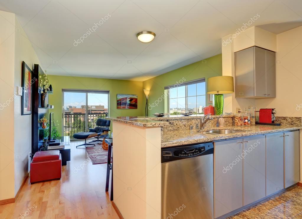 Open Floor Plan Modern Living Room With Green Walls View