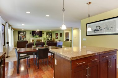 View of kitchen island and dining area