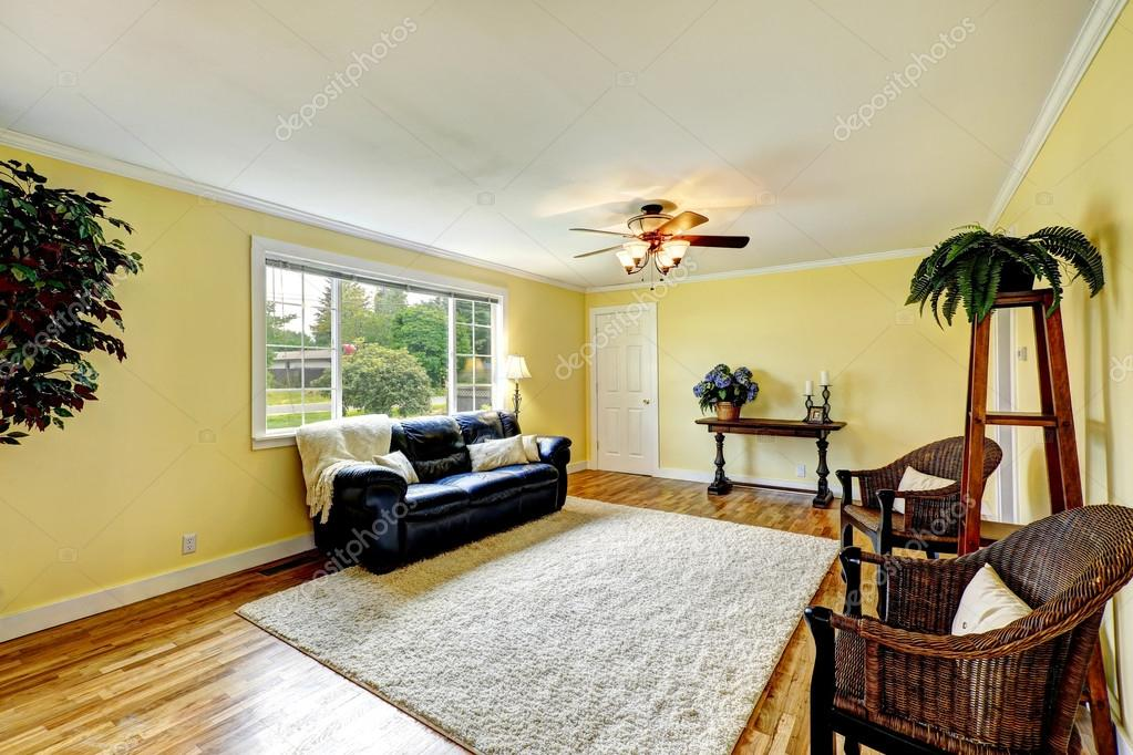 Bright living room with yellow and red walls — Stock Photo ...