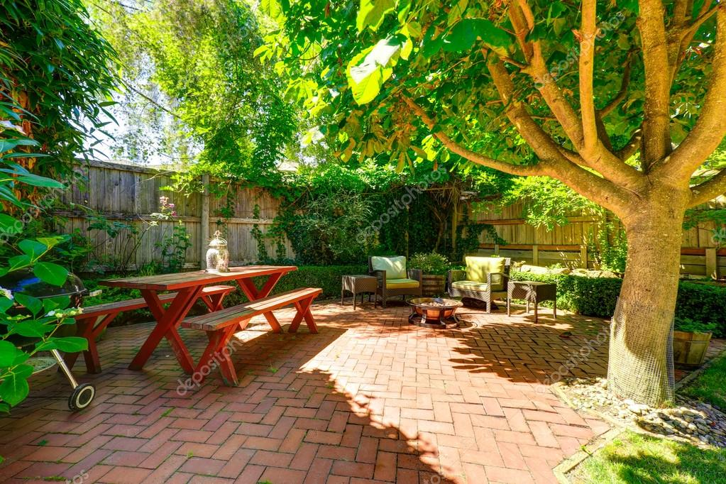 Cozy backyard patio area stock photo iriana88w 52822101 for Small outdoor patio areas