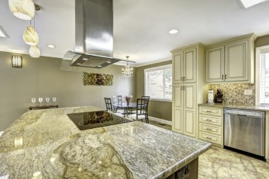 Beautiful kitchen island with granite top, built-in stove and ho