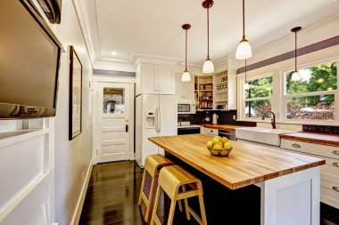 White kitchen with wooden counter top island