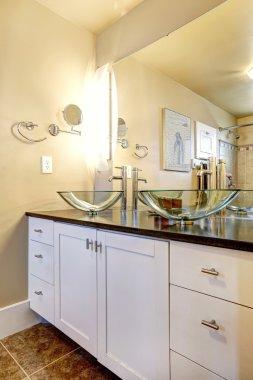 Bathroom vanity cabinet with glass vessel sinks
