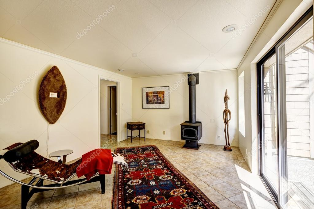 Bright room with resting area and antique stove