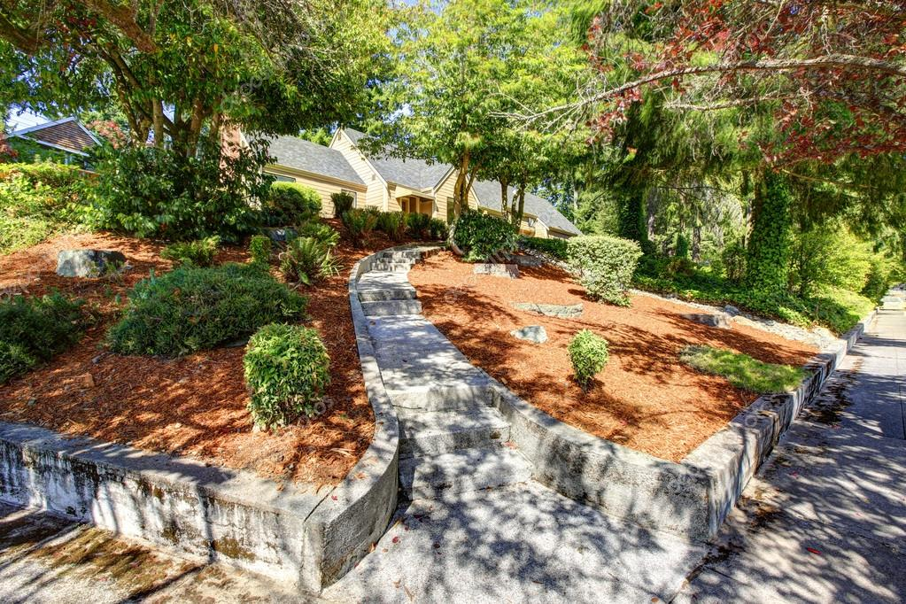 Front Yard Landscape With Concrete Walkway And Stairs Stock